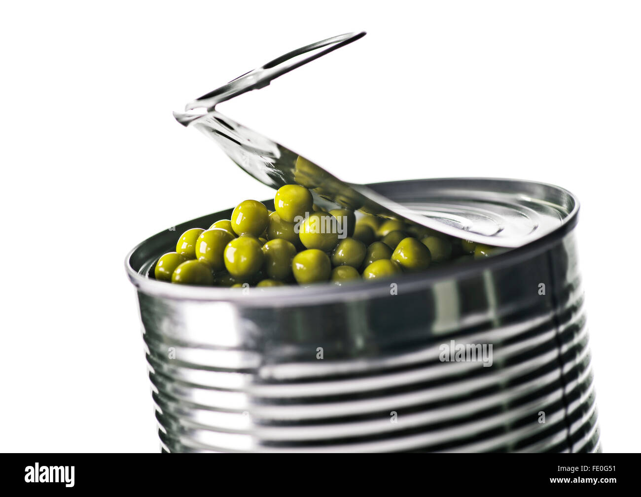 Opened food tin with peas Stock Photo