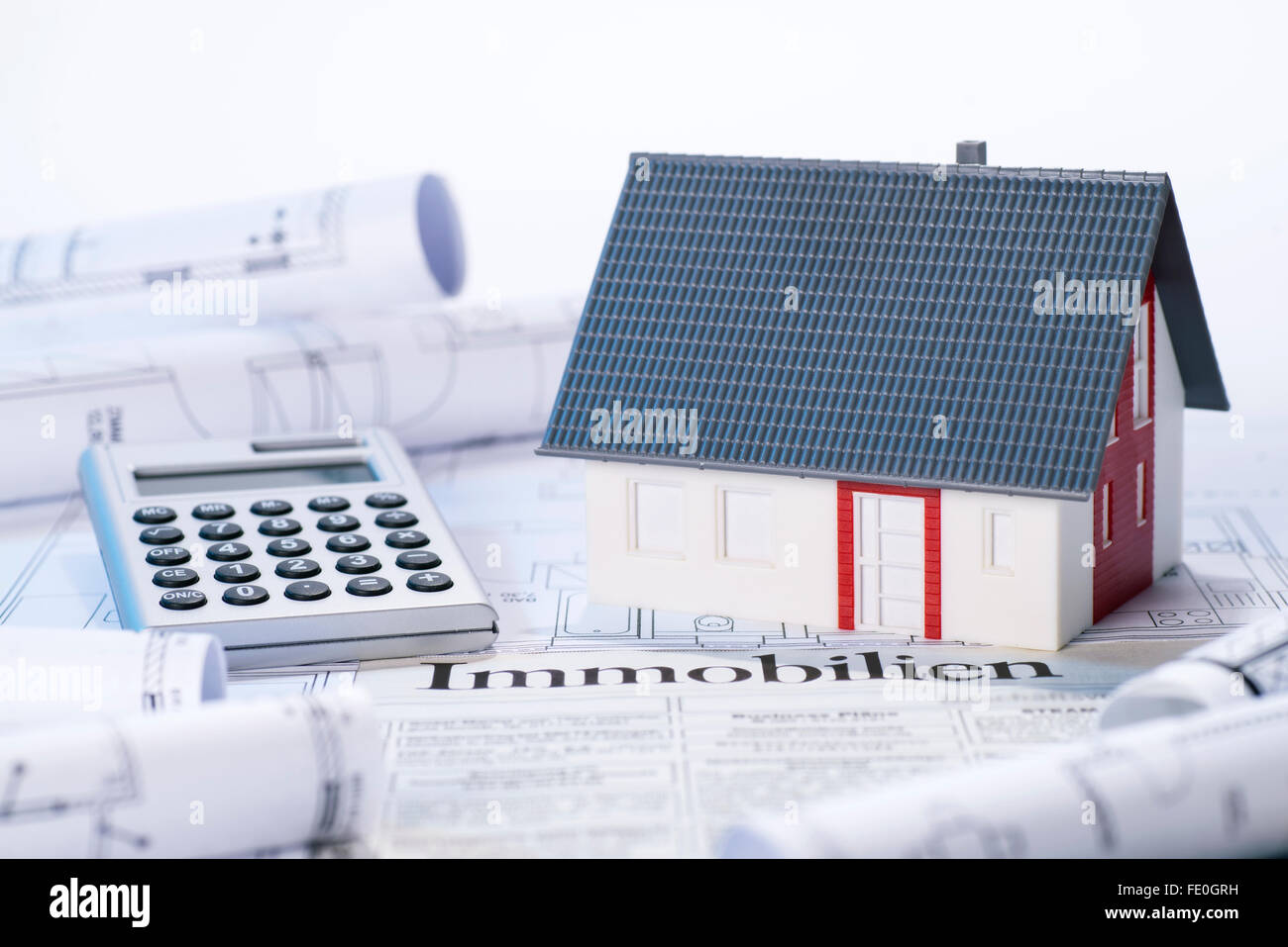 Property ad stock photos property ad stock images alamy house with blueprints real estate ads and calculator stock image malvernweather Gallery