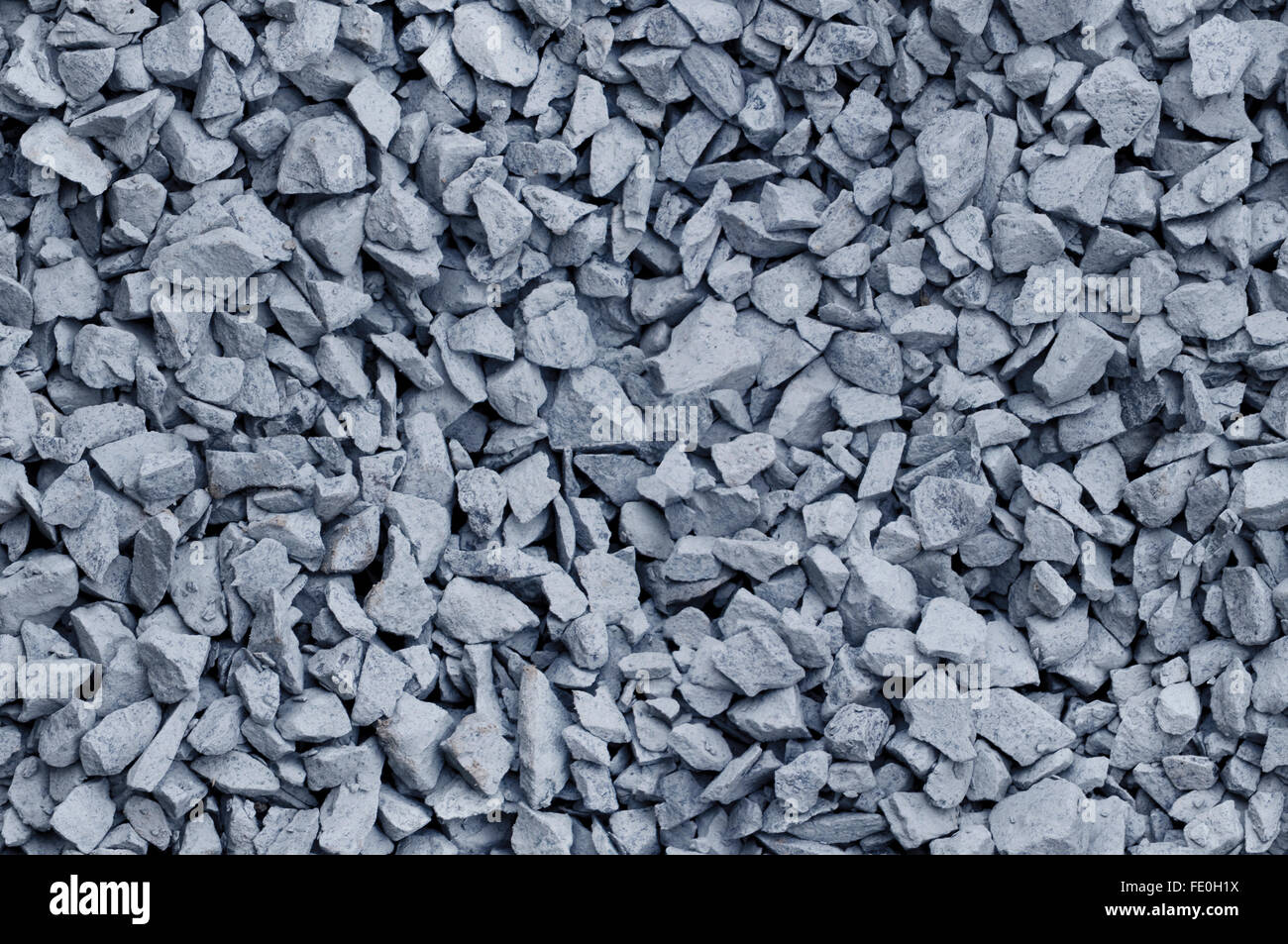 Bluish gray gravel used for construction fill, seamless background texture - Stock Image