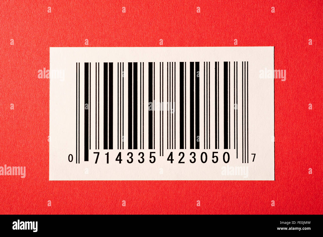 Bar Code On Red Textured Background - Stock Image