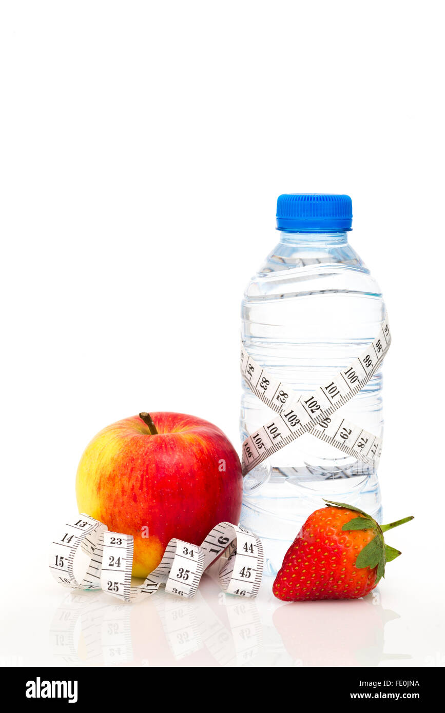 Water bottle wrapped in white metric tape measure with red apple and strawberry isolated on white background with - Stock Image