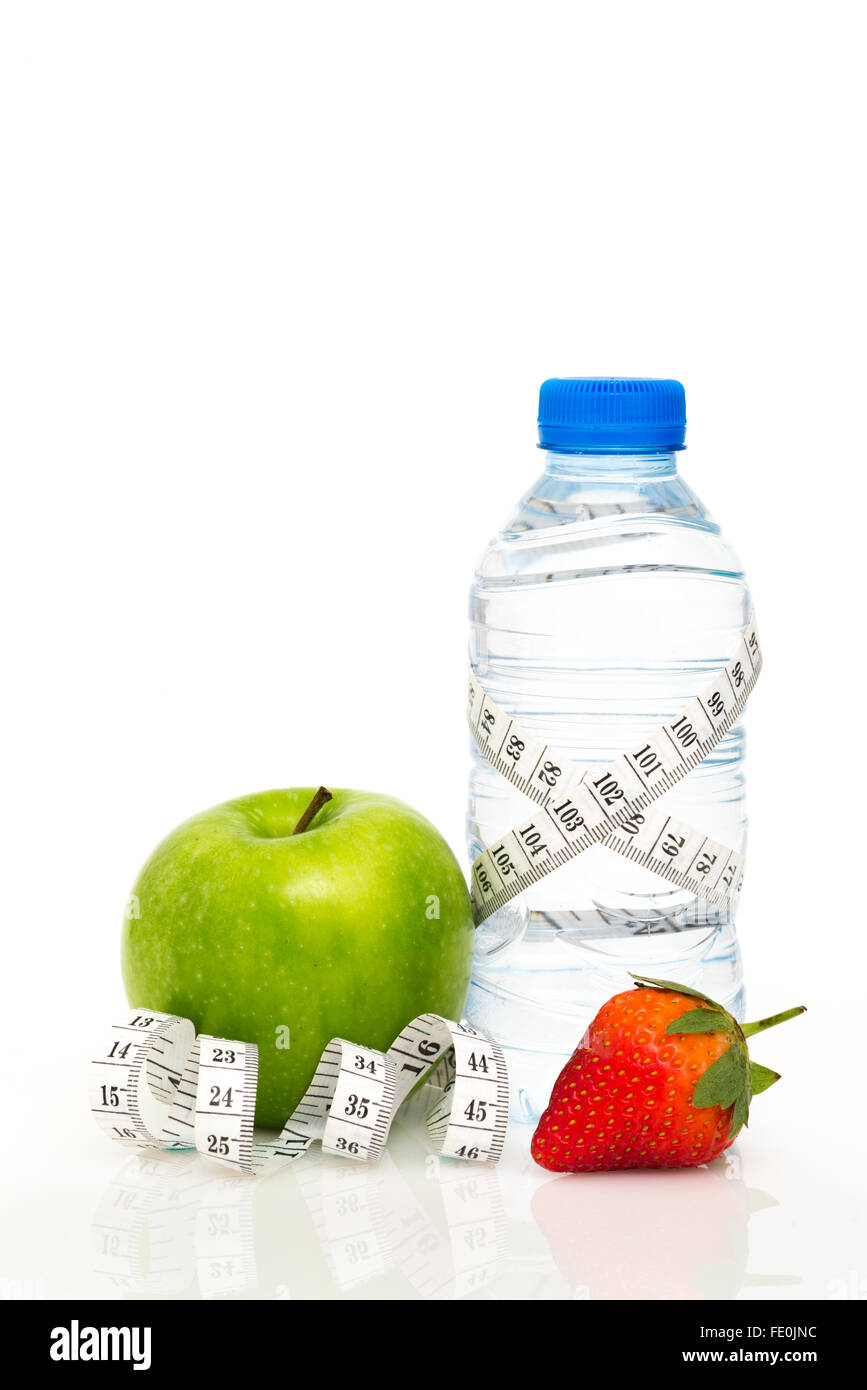 Water bottle wrapped in white metric tape measure with green apple and strawberry isolated on white background with - Stock Image