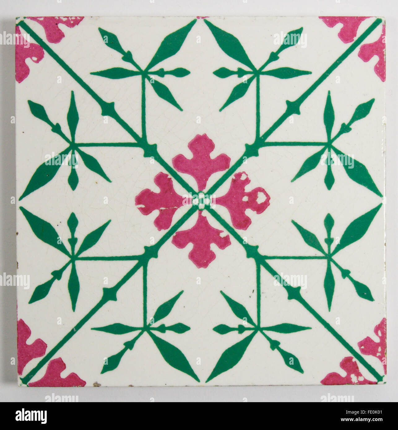 Antique Minton Gothic Revival tile designed by A.W.N. Pugin circa 1860. The printed and enamelled tile is in a striking - Stock Image
