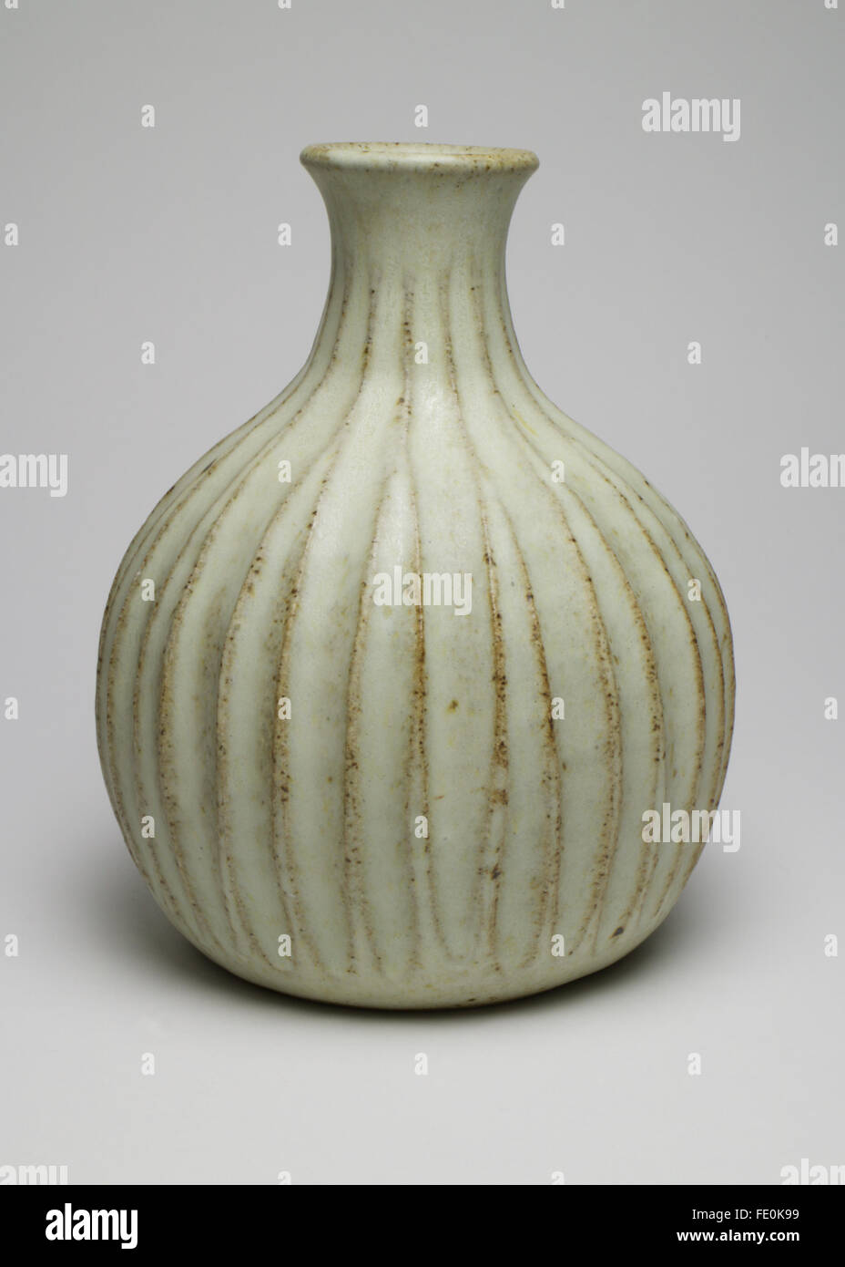 Stylish Peter Lane studio pottery bottle form fluted vase. The vase measures 14.5cm high and has Peter Lane's PL - Stock Image