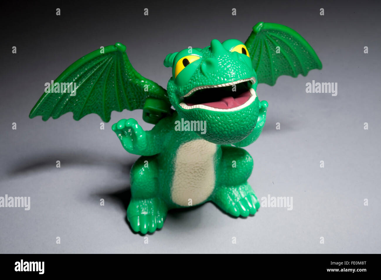 How to tame your Dragon happy meal toy on grey background - Stock Image
