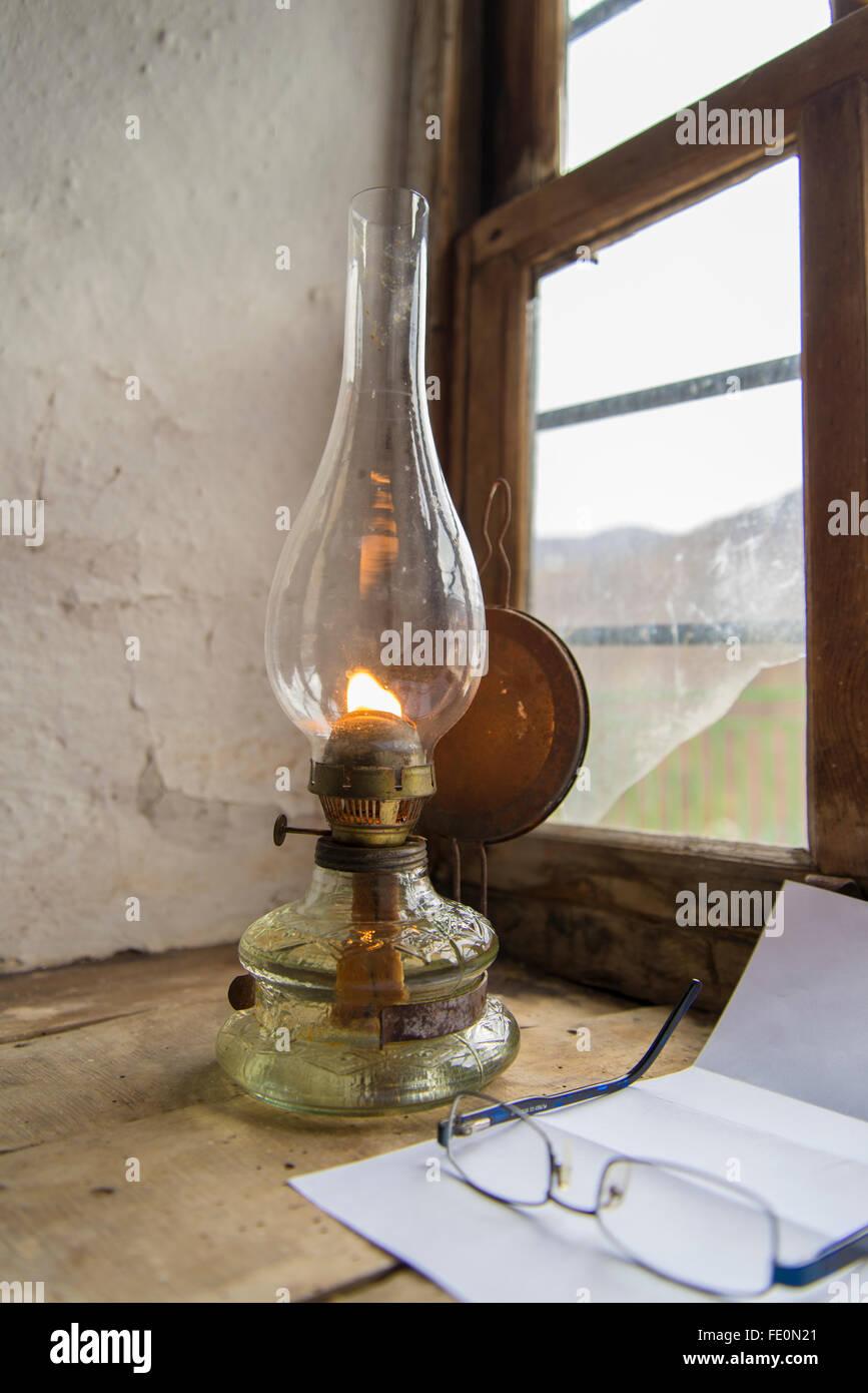 Vintage kerosene lamp at window - Stock Image