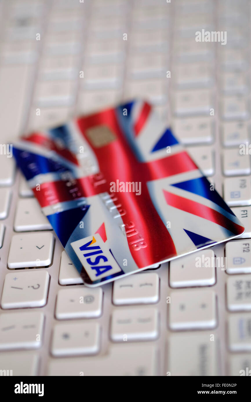 Credit card with union jack flag design sat on keyboard of windows credit card with union jack flag design sat on keyboard of windows netbook laptop reheart Image collections