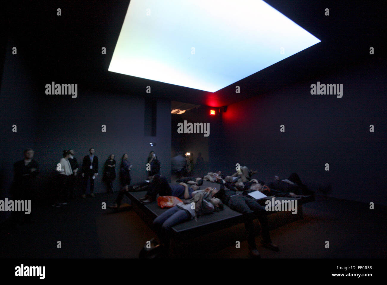 New York City, NY, USA. 3rd February, 2016. Visitors lying on a bed like platform, while overhead images of the - Stock Image