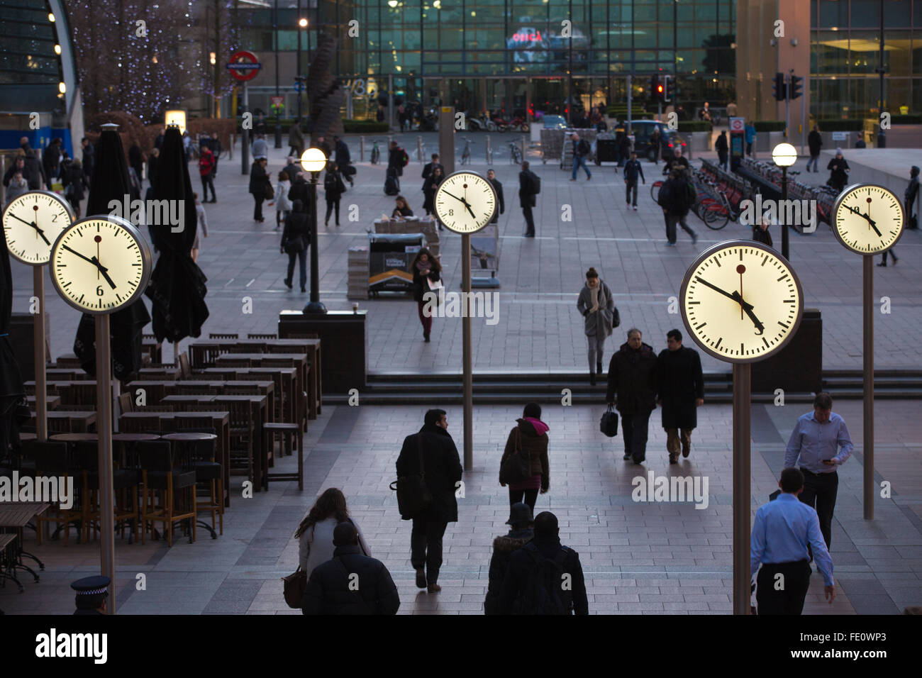 Public clocks outside Reuters Plaza in the heart of the financial district of Canary Wharf in the London Docklands, - Stock Image