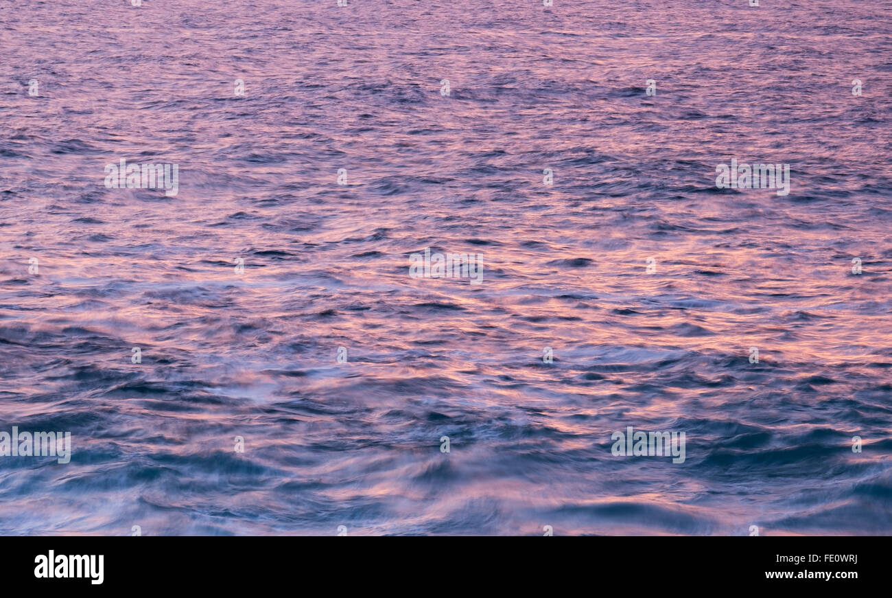 Gentle ocean waves at sunset, Atlantic, La Gomera, Canary Islands, Spain - Stock Image
