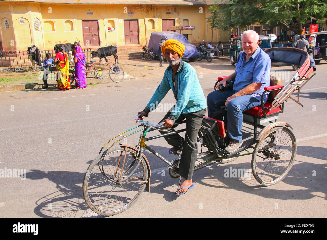 Cycle rickshaw near City Palace Chandra Mahal in Jaipur, India. Palace was the seat of the Maharaja of Jaipur, the - Stock Image