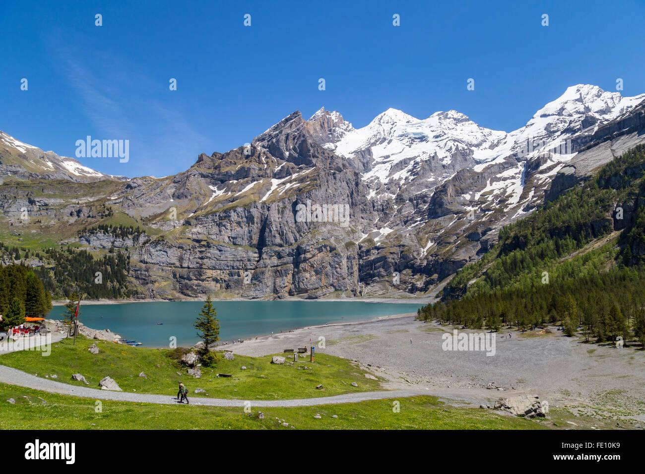 View of Oeschinensee (Oeschinen lake) with Bluemlisalp and Frundenhorn of Swiss alps on Bernese Oberland - Stock Image