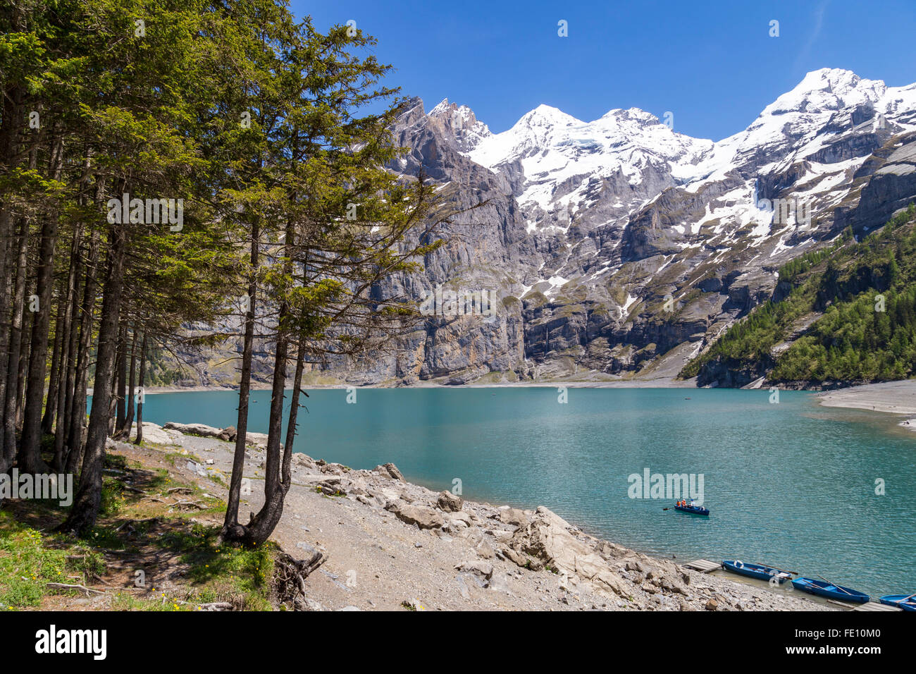 View of Oeschinensee (Oeschinen lake) with Bluemlisalp and Frundenhorn of Swiss alps on Bernese Oberland - Stock Image