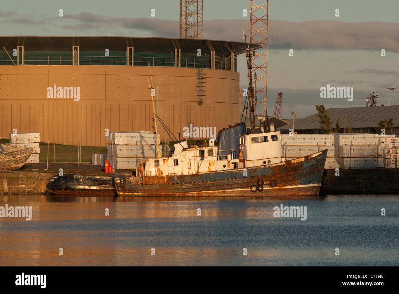 Rusting ship at sunset in Harbour docks, Dundee, Scotland, UK. - Stock Image