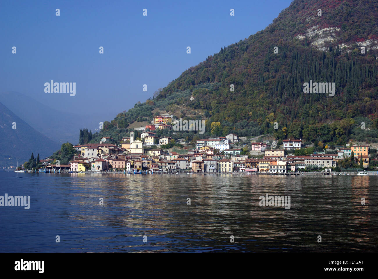 Town of Peschiera Maraglio. Country viewed from the Iseo lake in Lombardy region of Italy - Stock Image