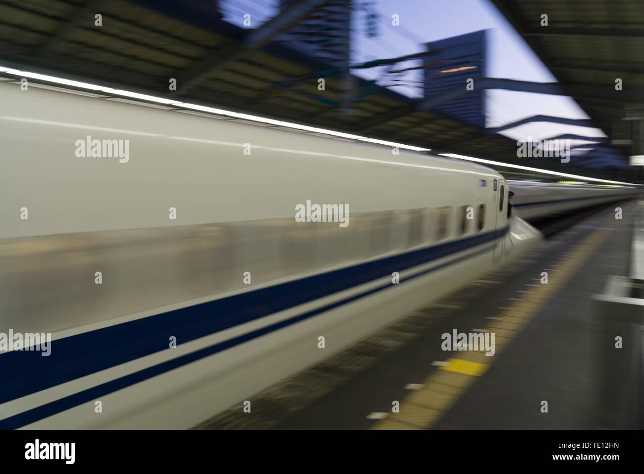 Shinkansen bullet train blurring in Japan - Stock Image