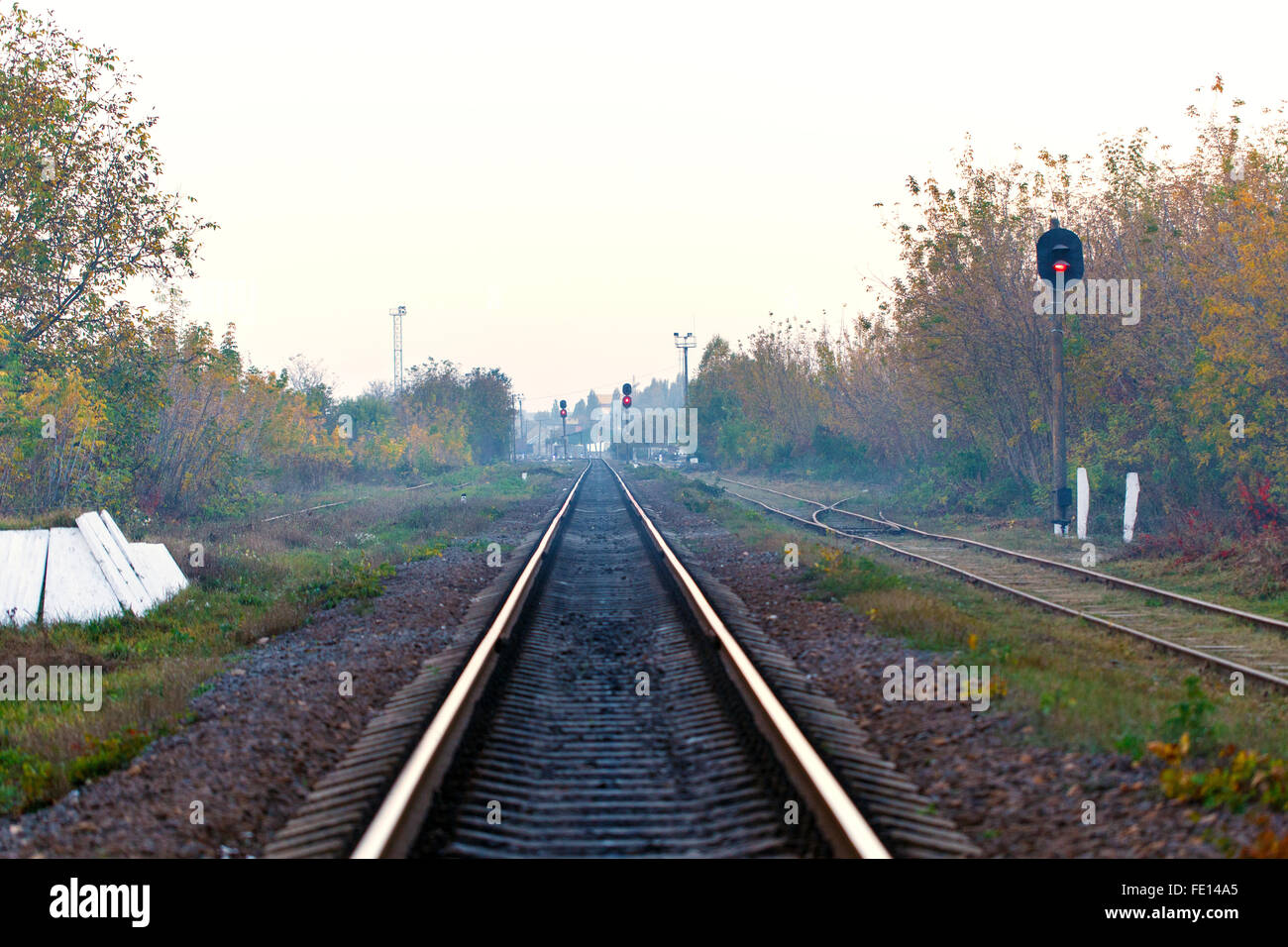 railroad tracks Transportation day leaving for horizon - Stock Image