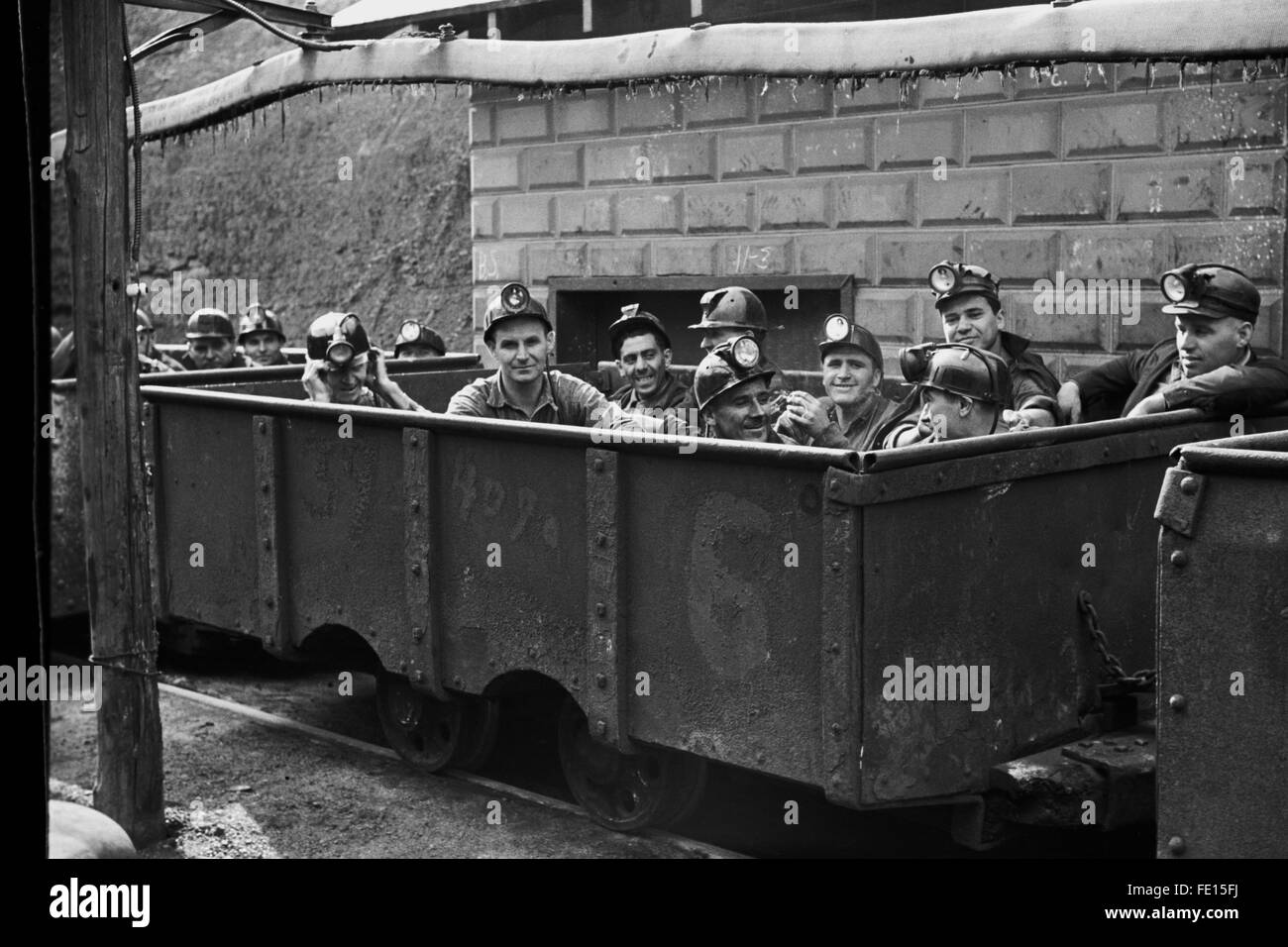 Miners in coal cars prepare to go to work in coal mine. Circa 1935. - Stock Image
