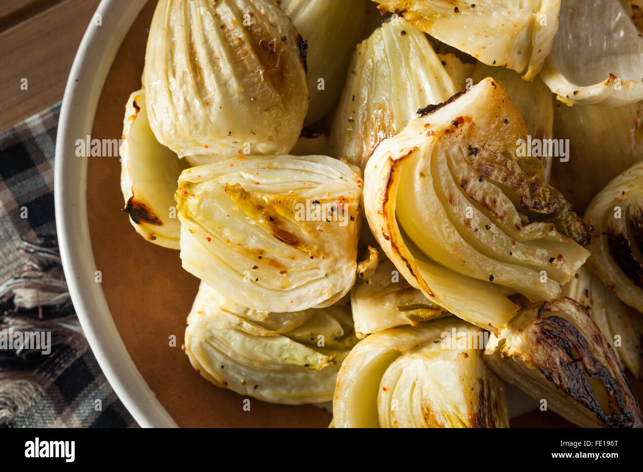 Organic Baked Fennel Bulbs with Salt and Pepper Stock Photo