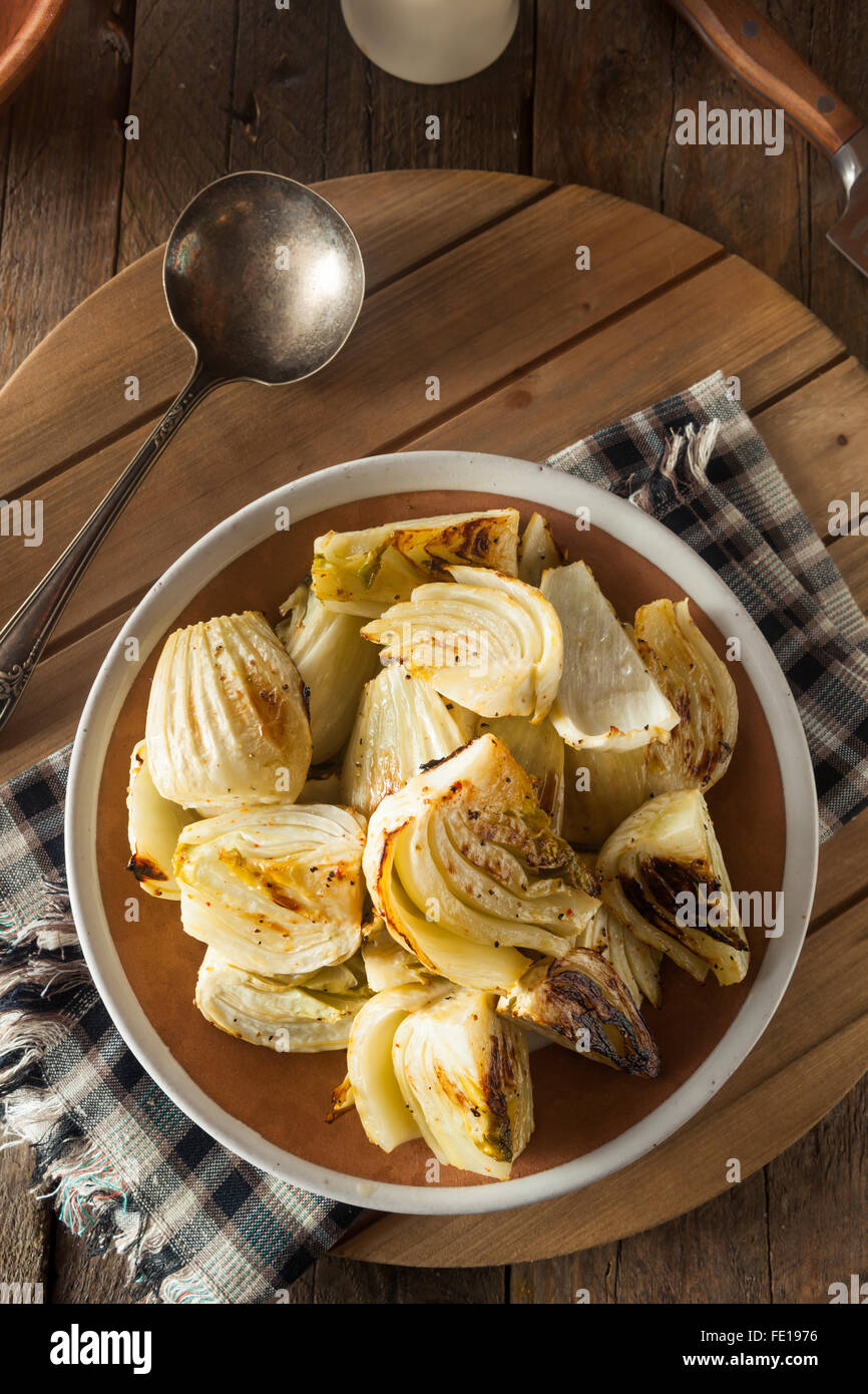Organic Baked Fennel Bulbs with Salt and Pepper - Stock Image