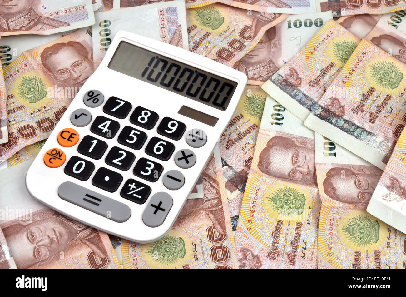 close up of 1000 baht banknotes and calculator - Stock Image