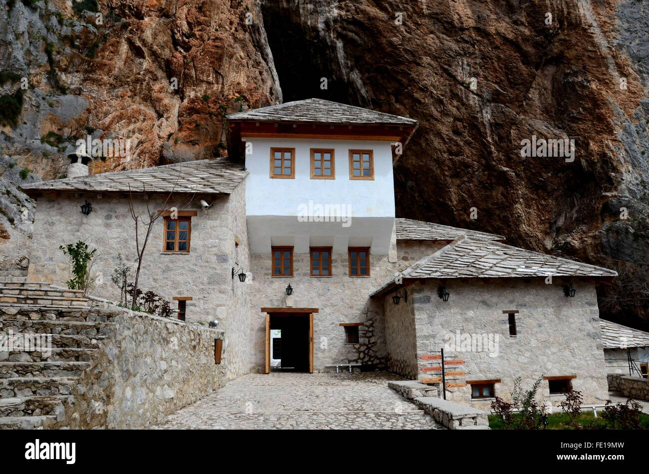 Blagaj Sufi Muslim dervish stone monastery structure in mountains Bosnia Herzegovina - Stock Image