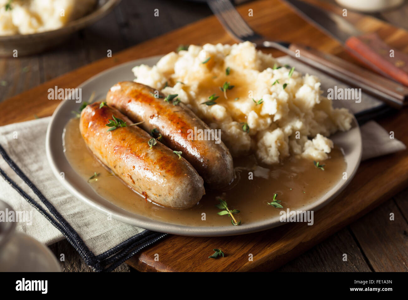 Homemade Bangers and Mash with Herbs and Gravy Stock Photo