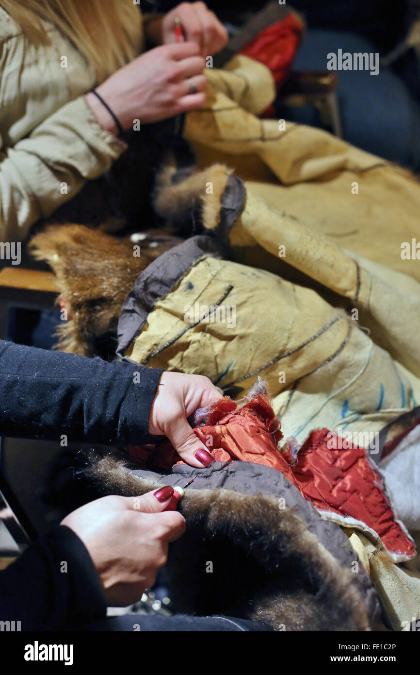 Minneapolis, Minnesota, USA. 03rd Feb, 2016. Volunteers remove linings, buttons and zippers from old, donated fur - Stock Image