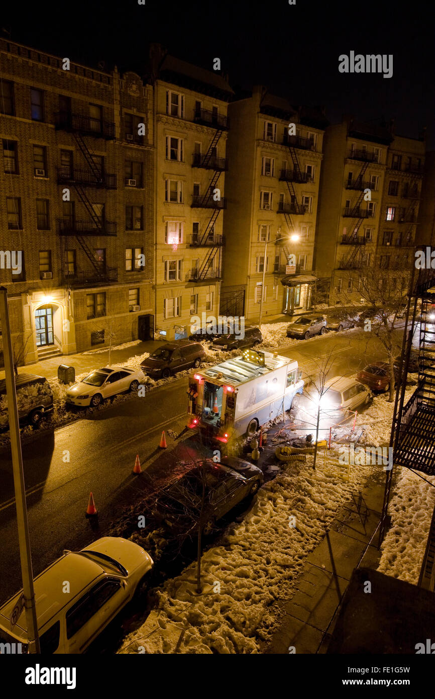 Con Edison Work Van parked on a New York Street beside a steaming manhole on a cold New Year's Eve night in - Stock Image
