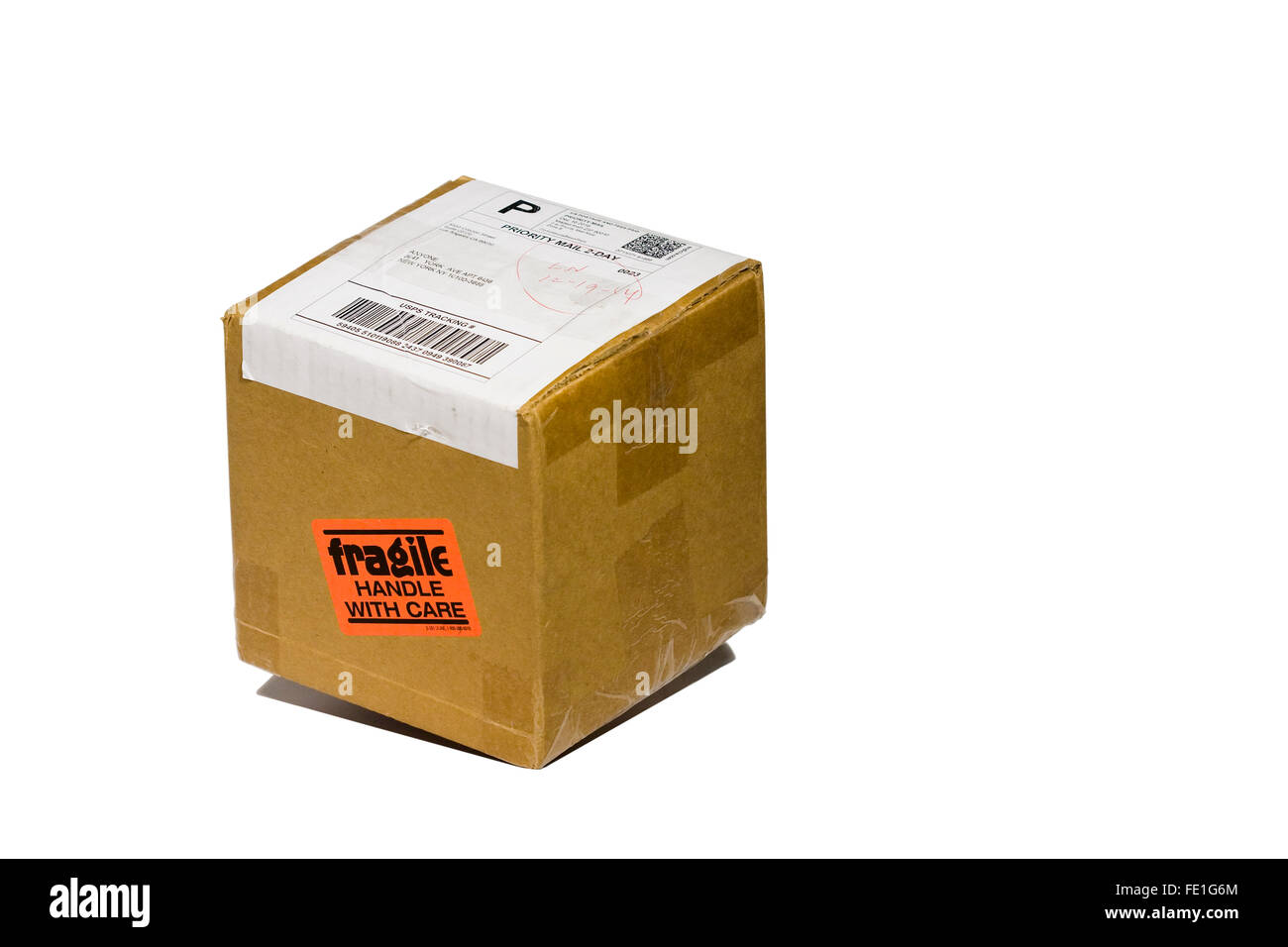 Cut Out. Falling Cardboard Box. Fragile Handle With Care Sticker on box being sent by US Postal Service Priority - Stock Image