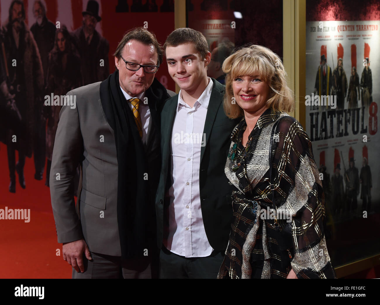 Designer Nanna Kuckuck(R), her husband Dirk Ullmann (L) and her son Mel arrive to the German premiere of the - Stock Image