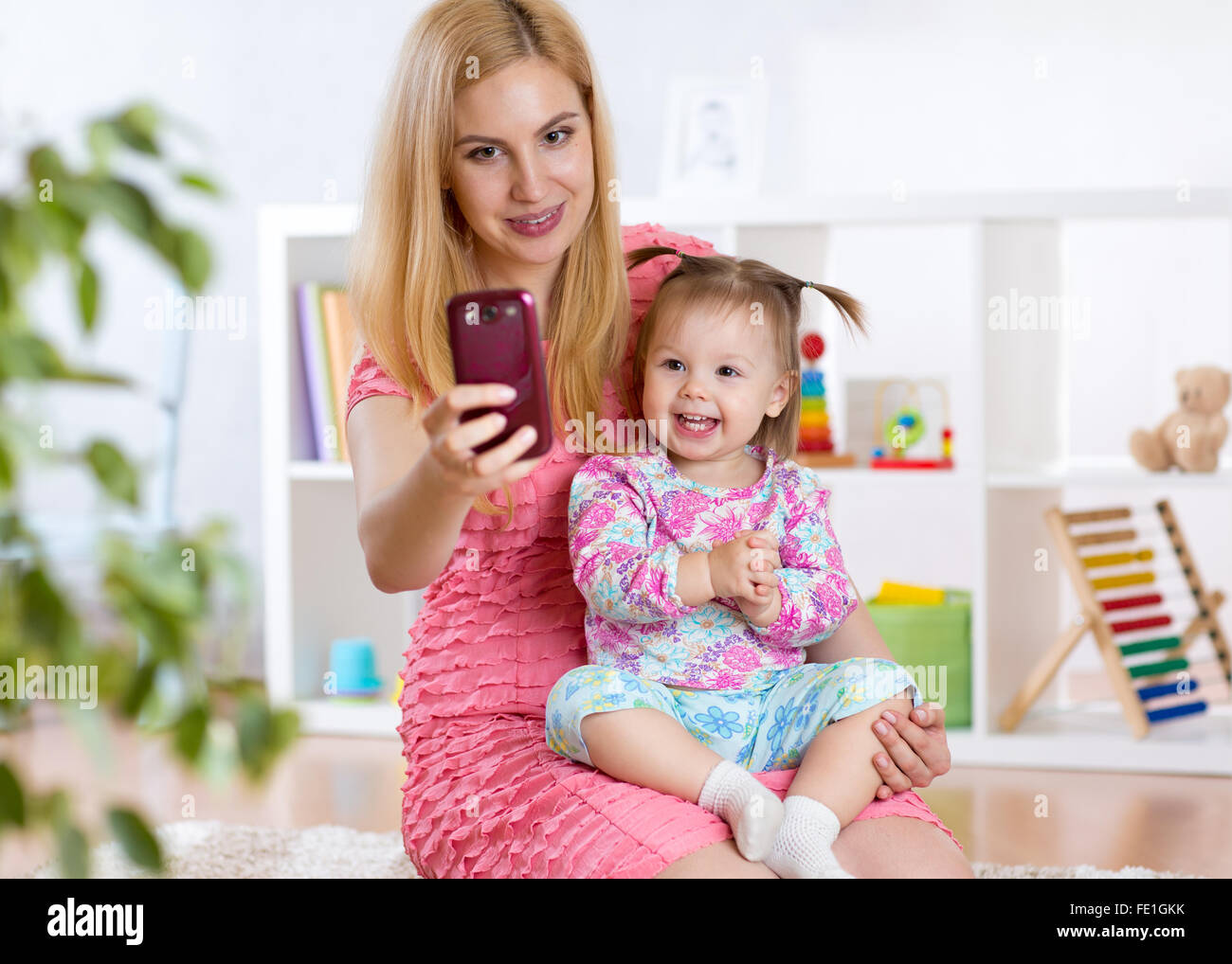 Mother and daughter taking selfie - Stock Image