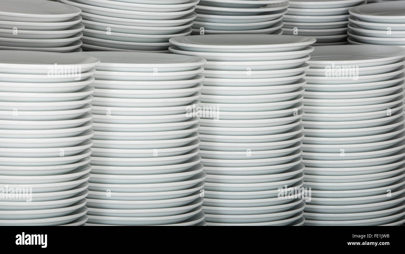 Stacks Of Many White Plates On A Wire Rack Shelf In Commercial Wiring For Dummies Kitchen