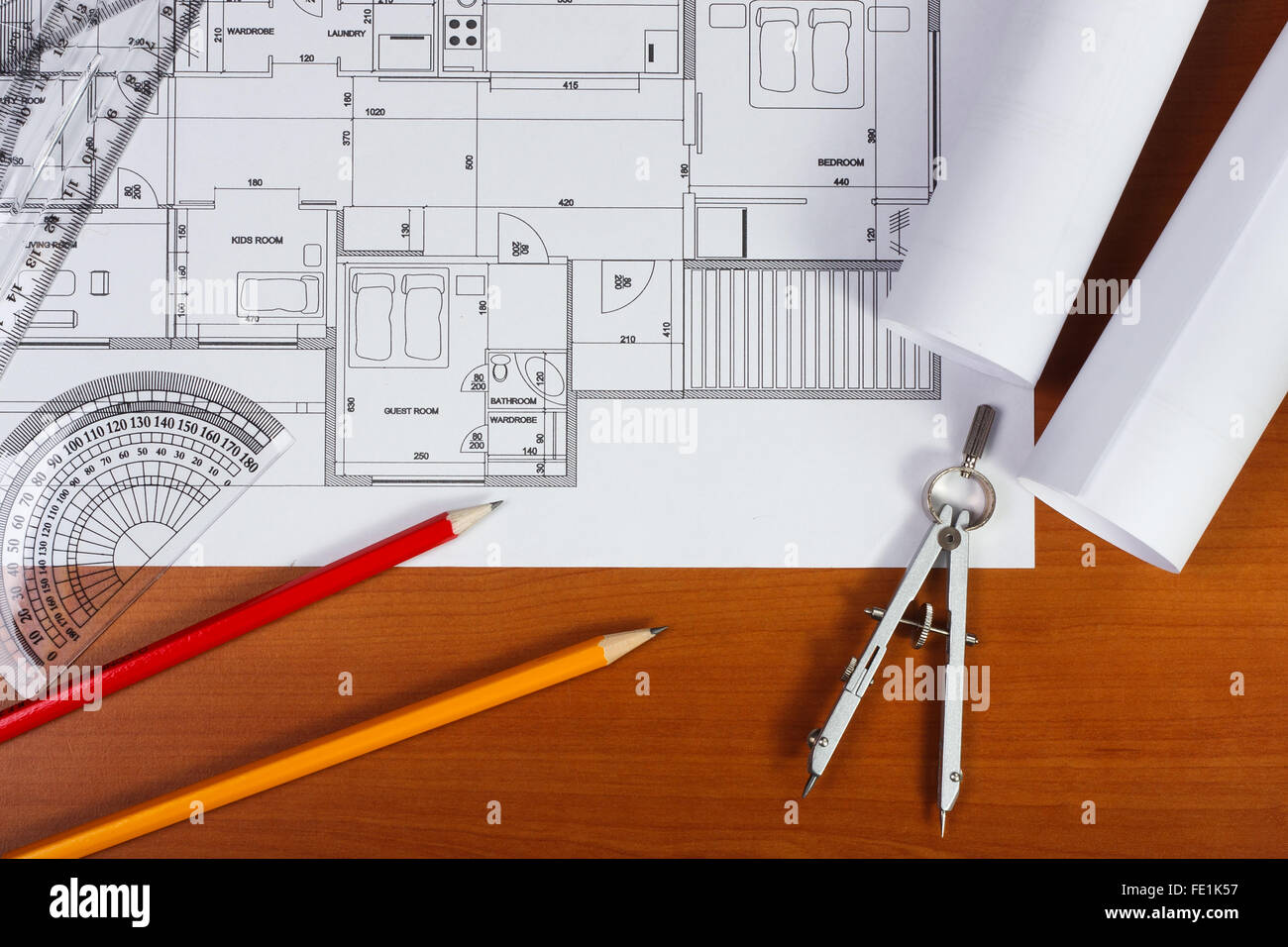Architectural plans, pencils and ruler on the desk - Stock Image