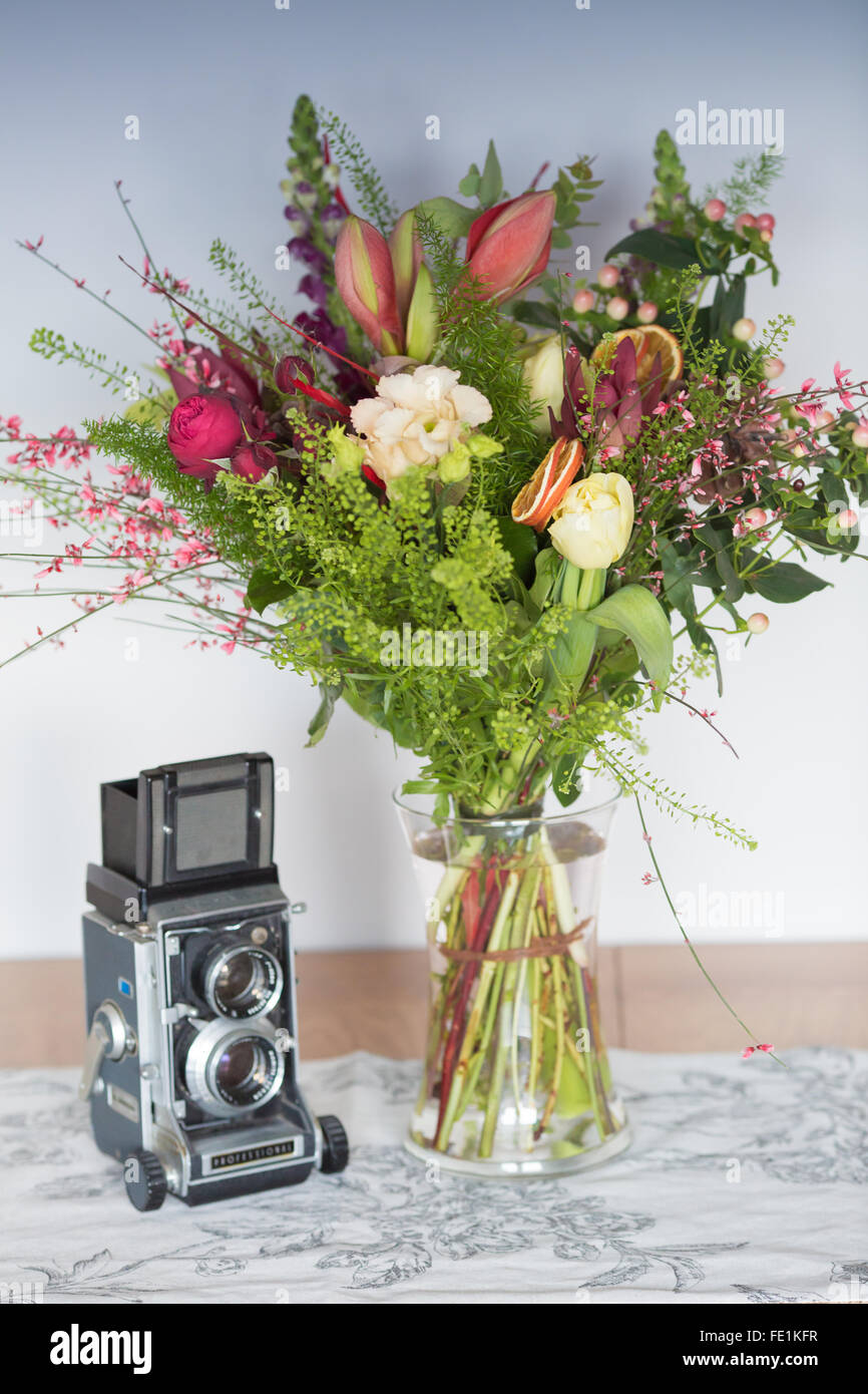 Winter Bouquet Of Flowers In A Vase With A Vintage Camera Stock Photo Alamy