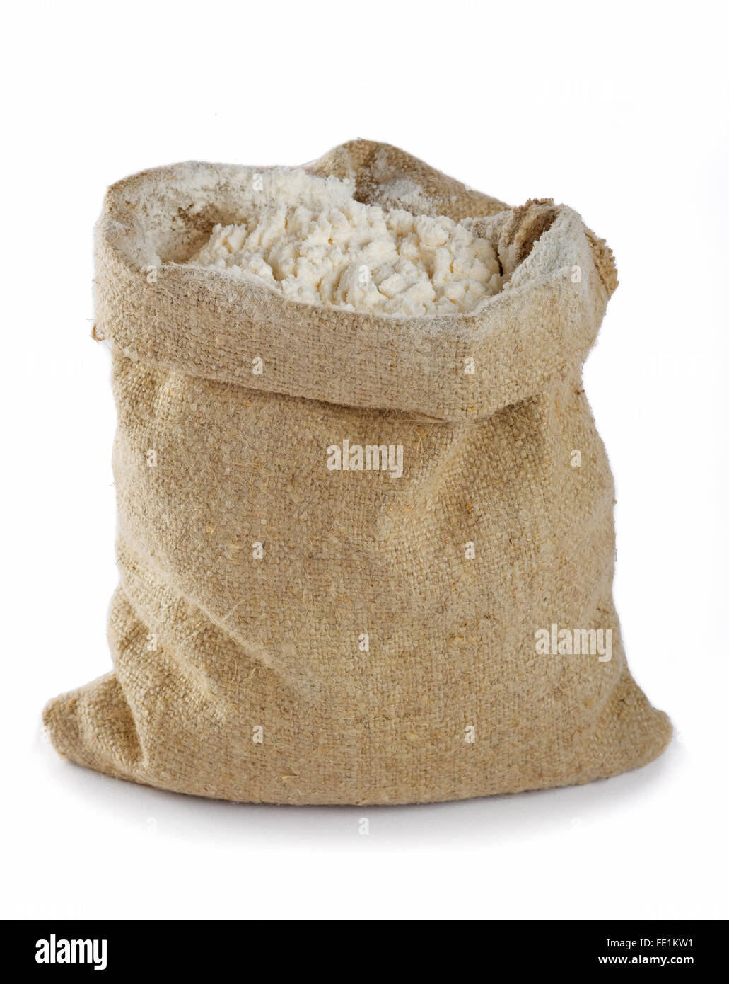 Flour in canvas bag isolated on white background - Stock Image