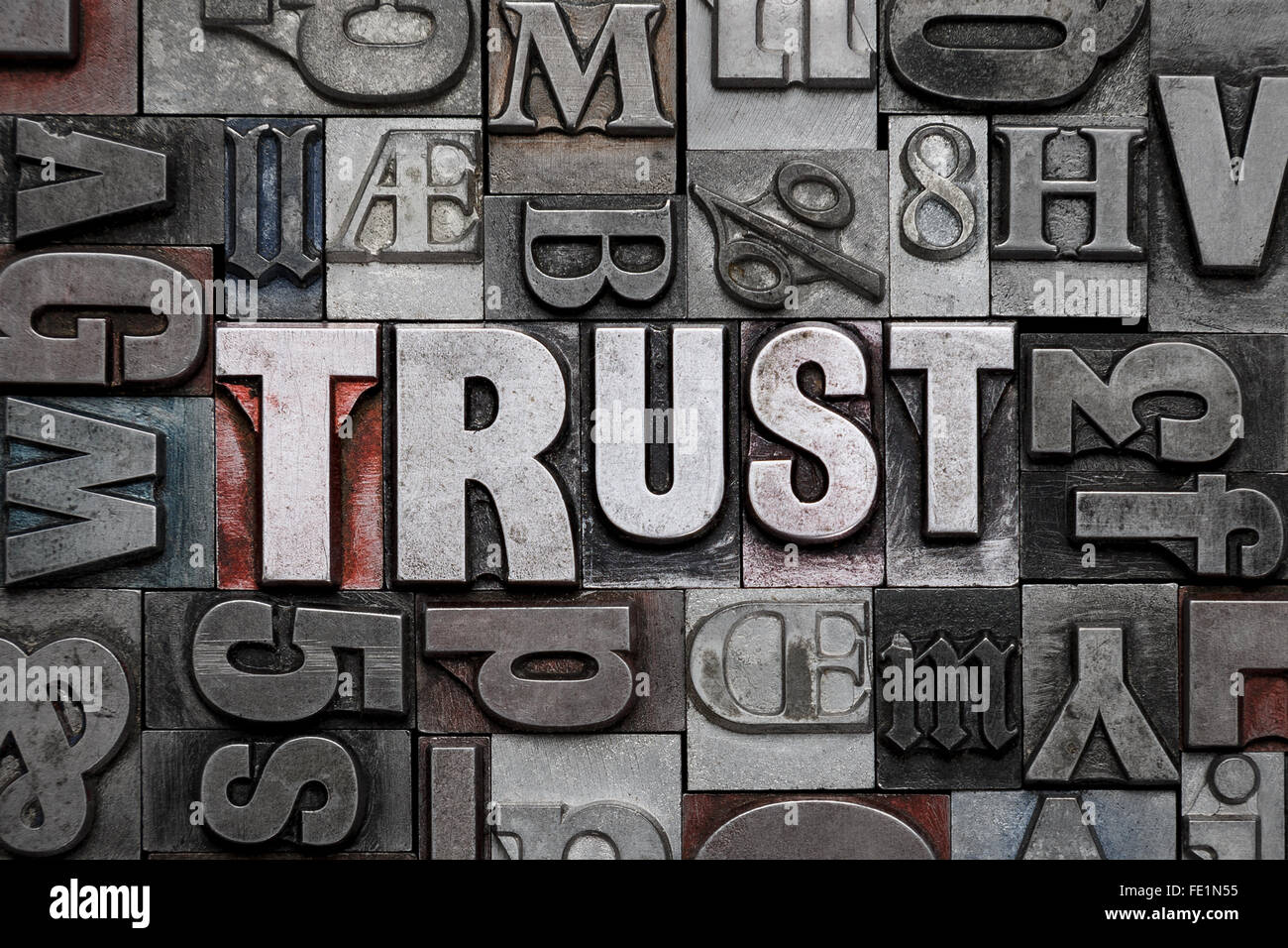 The word TRUST in old metal letterpress - Stock Image