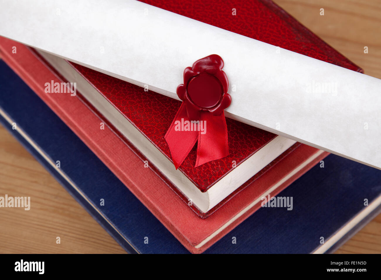 A wax sealed certificate on top of some old books, blank seal with copy space. - Stock Image