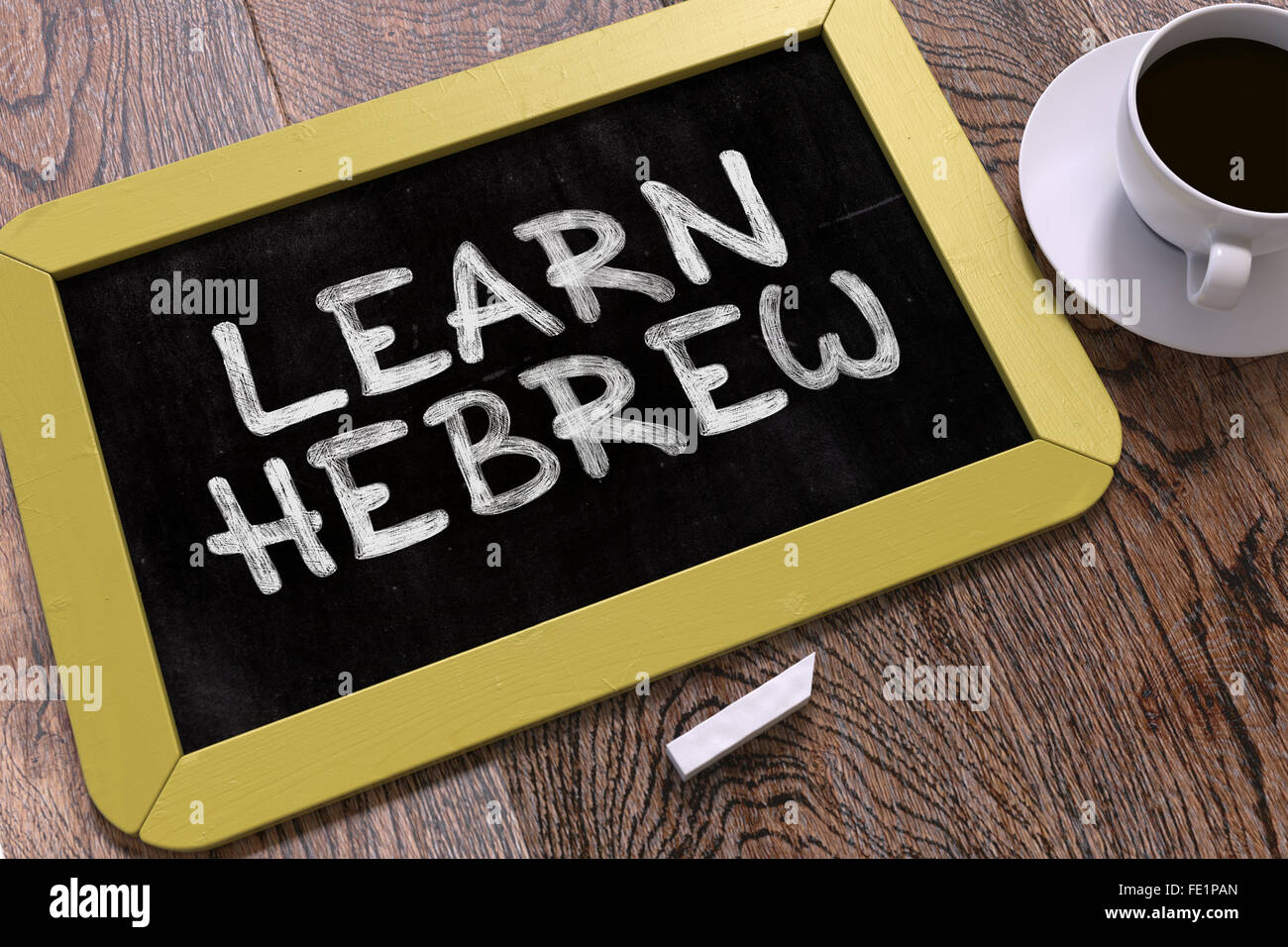 Hand Drawn Learn Hebrew Concept on Chalkboard. - Stock Image