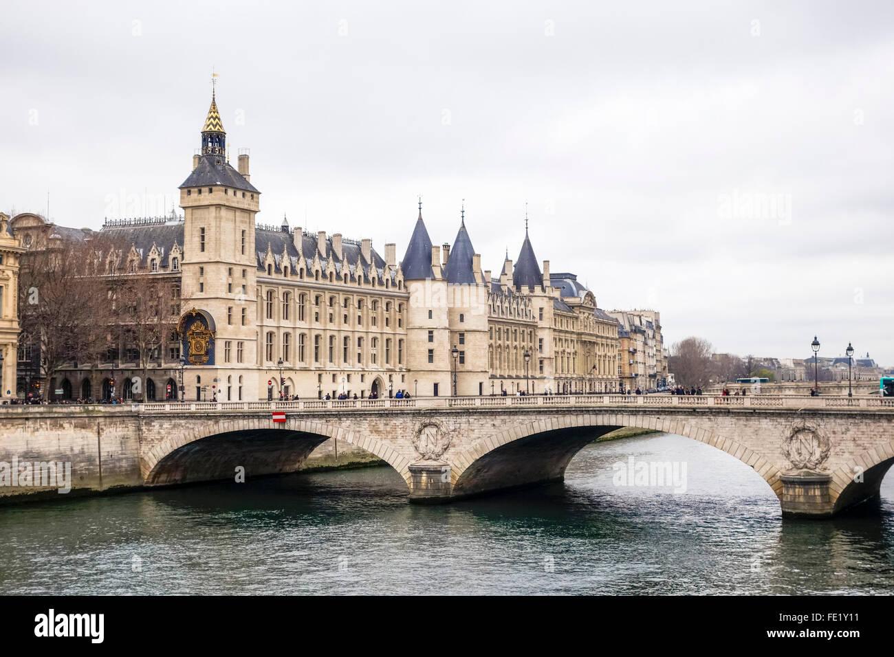 South facade of the Palais de Justice, front facade buildings, with pont au Change, bridge, Paris, France. - Stock Image