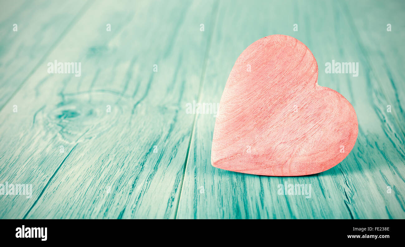 Cross processed heart on wooden background, space for text. - Stock Image