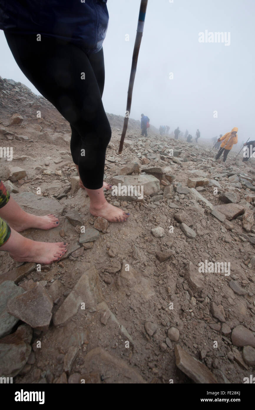 Barefoot pilgrims on Croagh Patrick, Reek Sunday, County Mayo, Ireland. - Stock Image