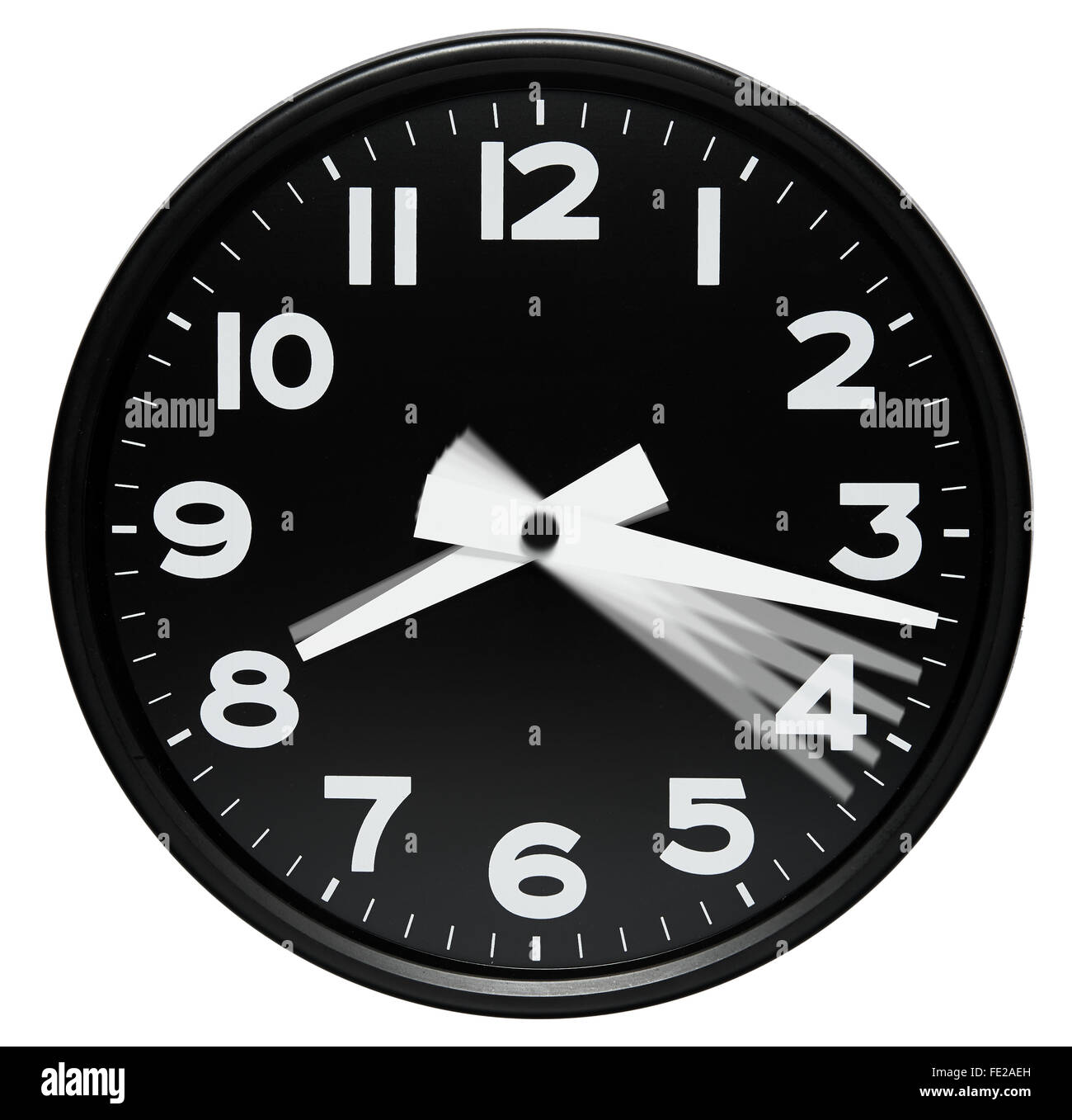 Clock dial showing passing minutes as motion blur positions of the minute hand in one minute increments - Stock Image