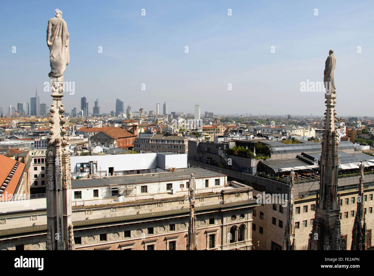 New skyline of Milan.View from the top of the Duomo. In the foreground the houses of the old town. In the background - Stock Image