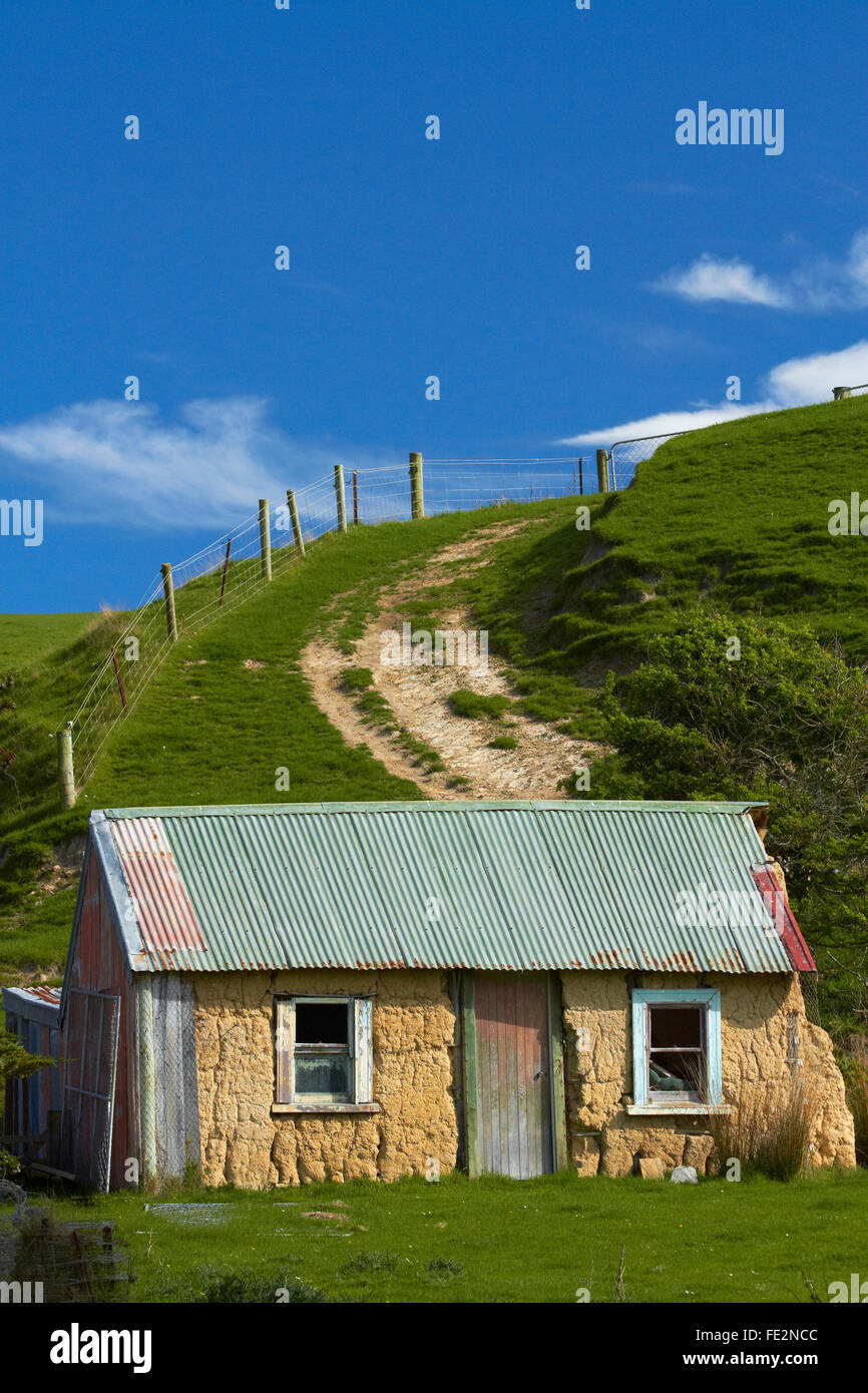Historic sod Cottage near Brighton, Dunedin, Otago, South Island, New Zealand - Stock Image