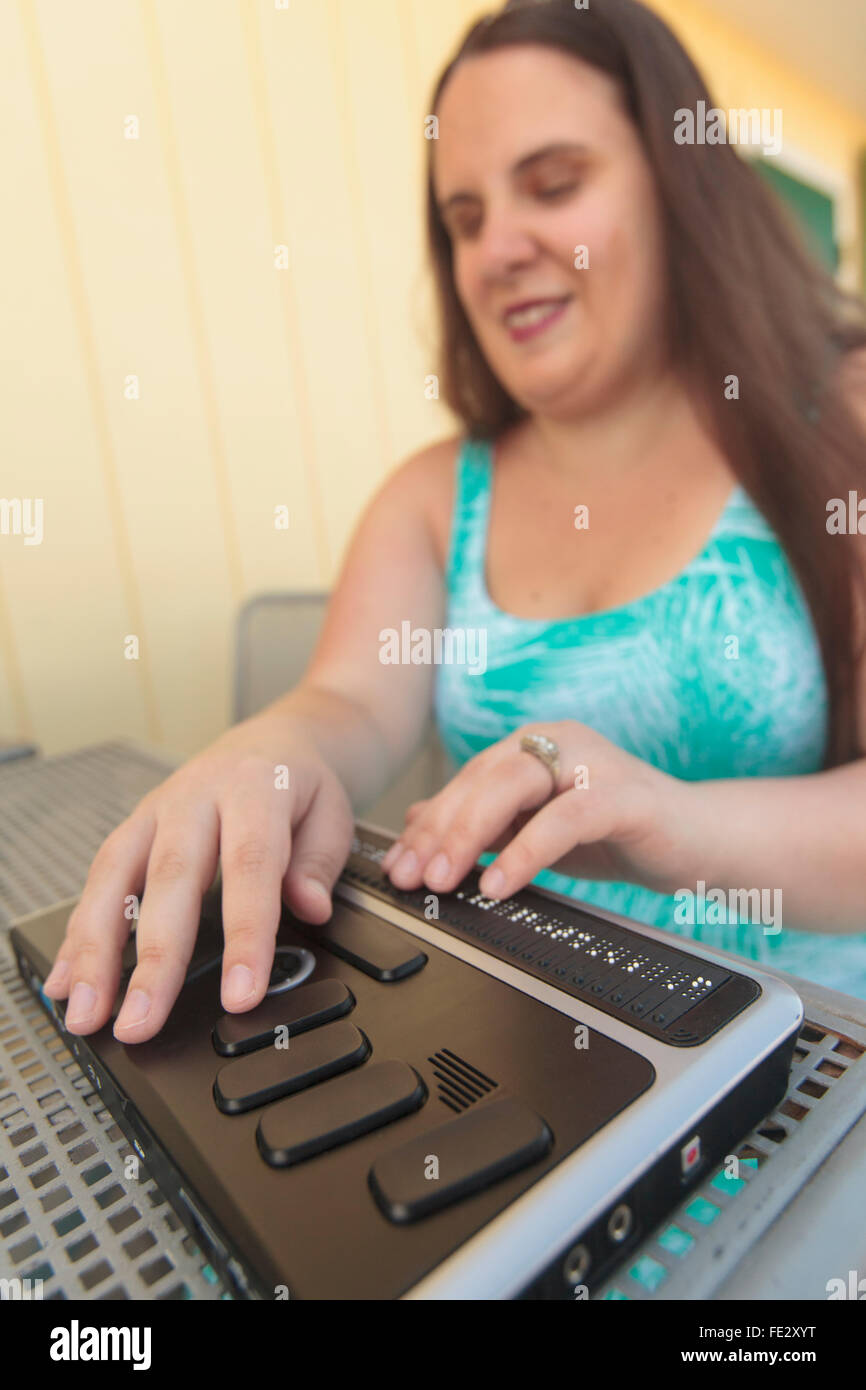 Blind woman using her assistive technology to communicate - Stock Image