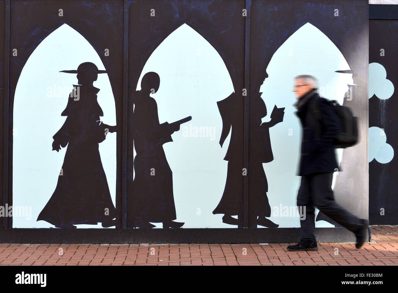 Lewes, UK. 4th February, 2016. An artist has embellished the otherwise drap cladding of a development in the centre - Stock Image