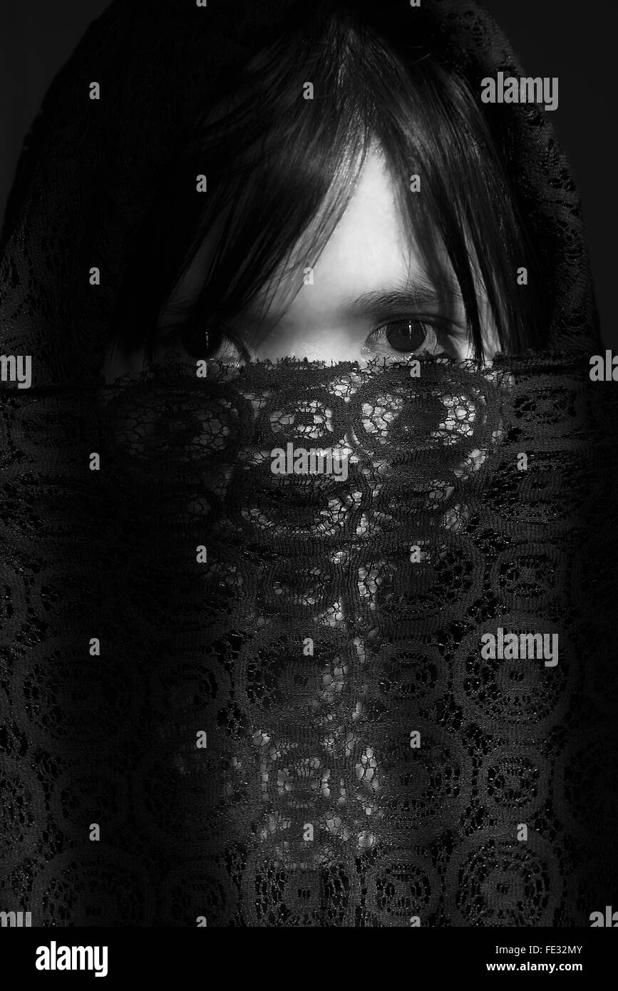 Portrait Of Woman Covering Face With Lace Cloth - Stock Image