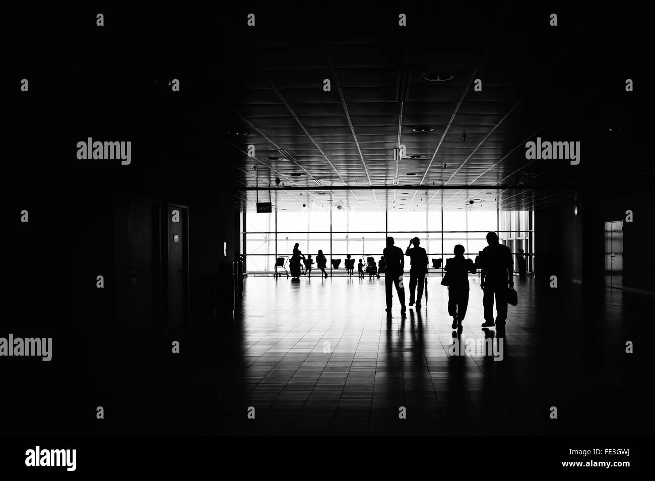 Silhouette People At Airport Terminal - Stock Image