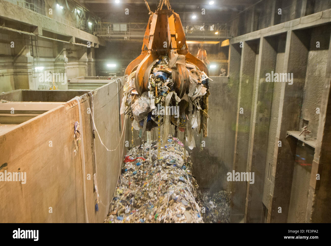 Hanover, Germany. 04th Feb, 2016. A crane transports waste to an 'EEW Energy from Waste' waste burning facility Stock Photo